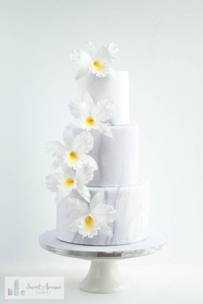 marble fondant wedding cake with white sugar orchids