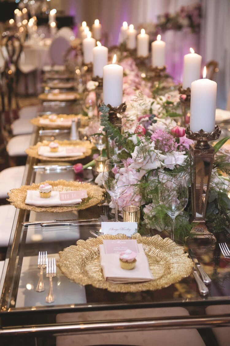 blush-gold-wedding-reception-chargers-cupcakes-candles-flowers