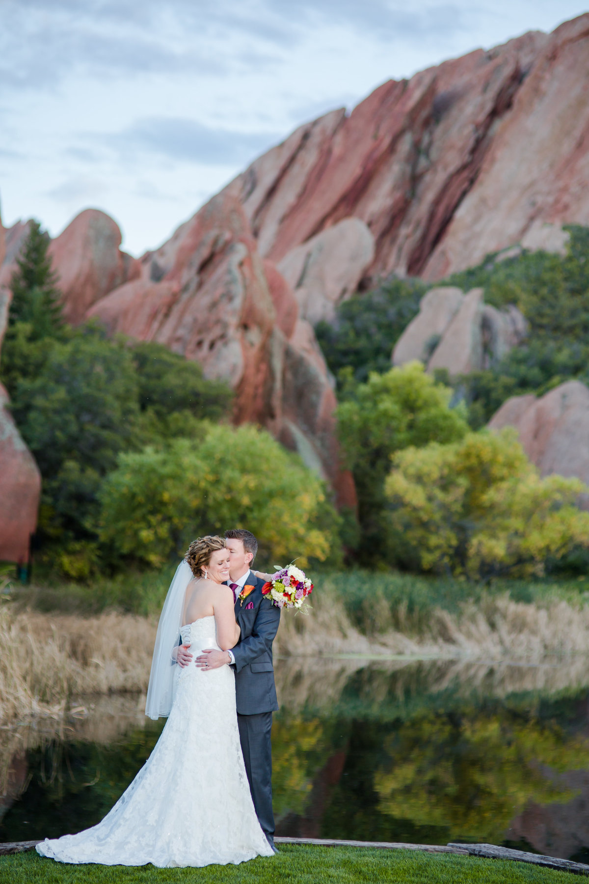 Bride and groom with red rocks of Arrowhead