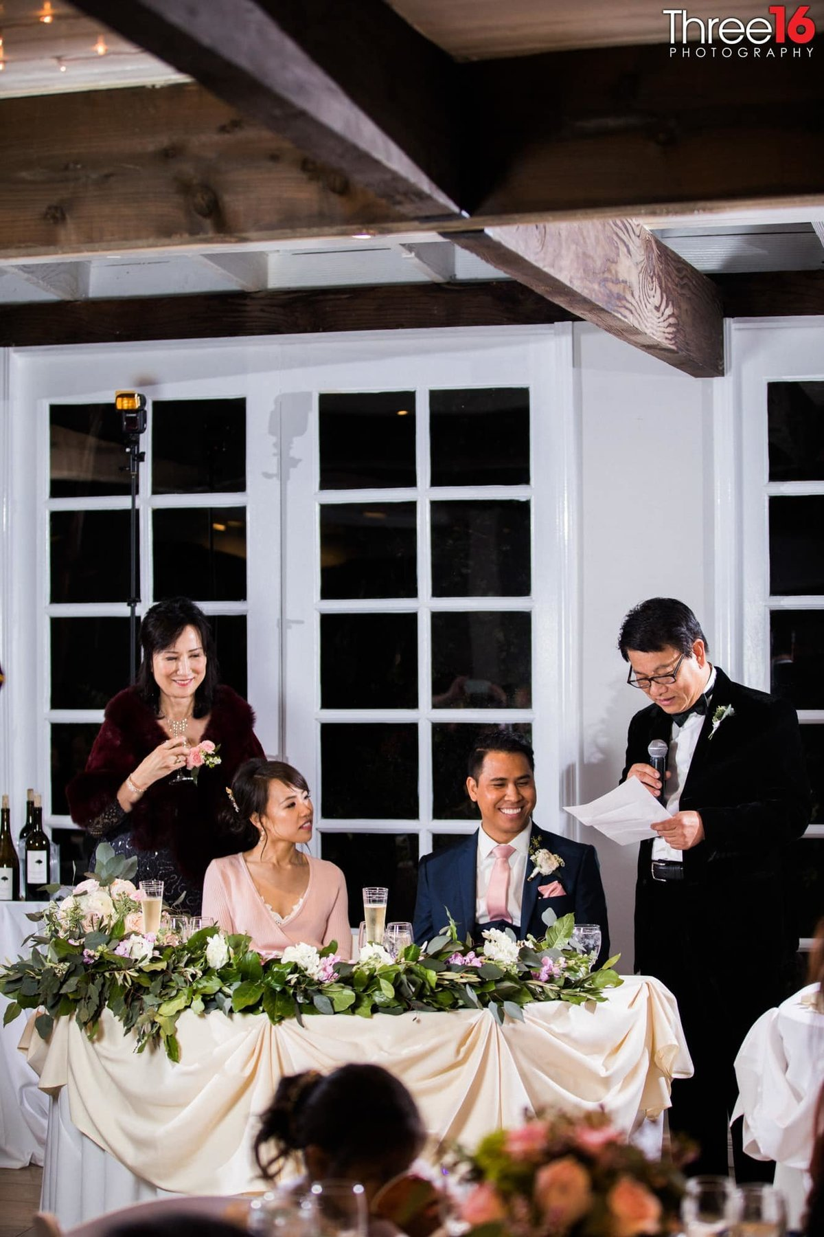 Best Man toasts the newly married couple at the wedding reception