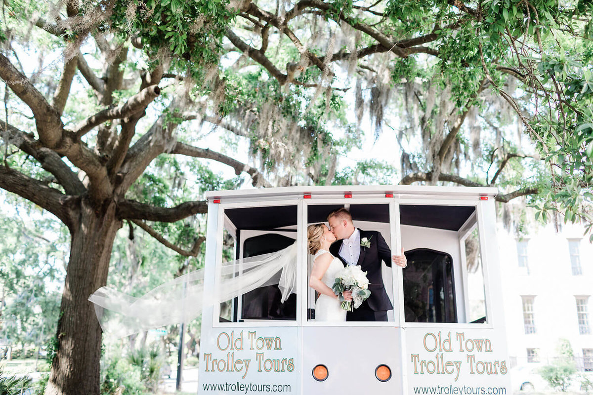 Bride and groom on Old Trolley Tours in Savannah by Apt. B Photography