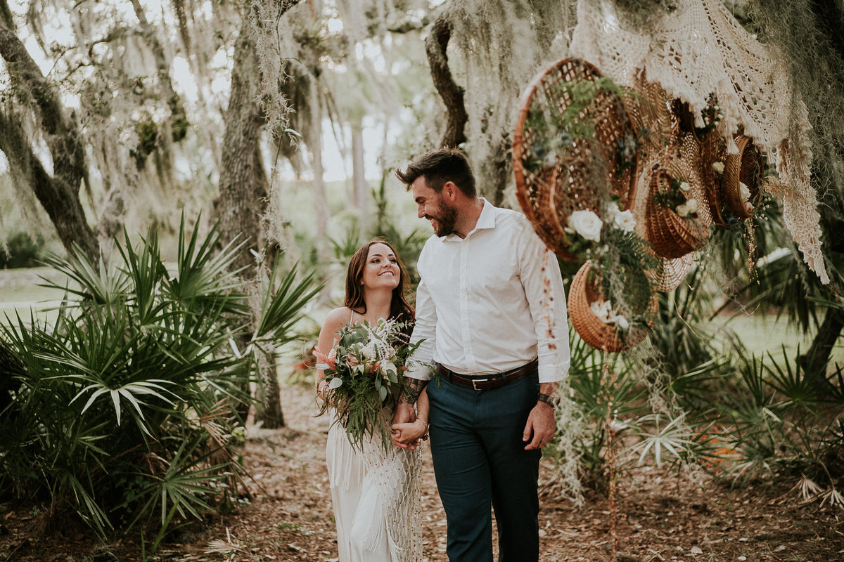Boho FL elopement couple walk through PSL Botanical gardens