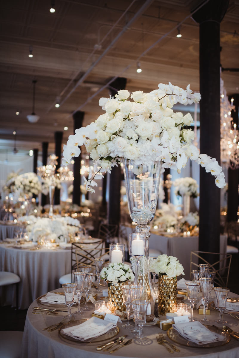 white floral centerpiece, reception decor, orchid