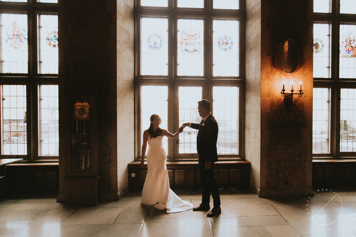 Bride and Groom in Mount Stephen Hall before their wedding reception at Fairmont Banff Springs, photo captured by Banff Wedding Photographer Lindsay Copeland of Twenty Twenty Photography