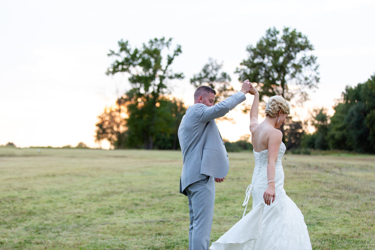 Romantic Sunset Fall Elopement  bride and groom dancing in field  at Kokopelli Golf Club  in Southern Illinois  by Amy Britton Photography Photographer in St. Louis