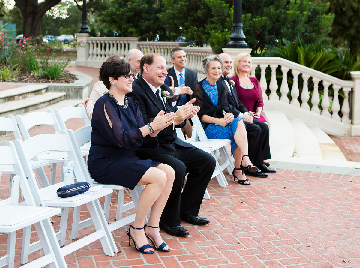 NOLA family members clap after just married couple kiss