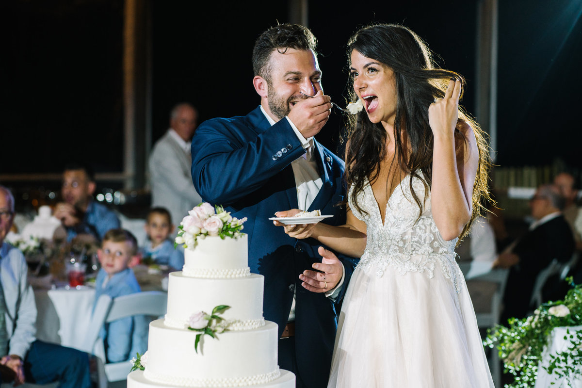 Bride and groom eat cake