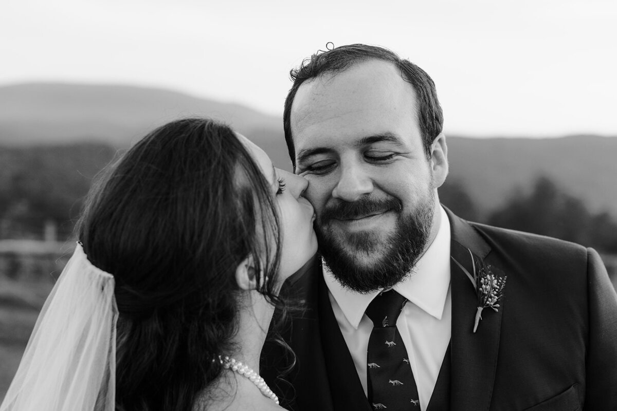 Bride and groom kiss at their 12 ridges vineyard wedding in virginia
