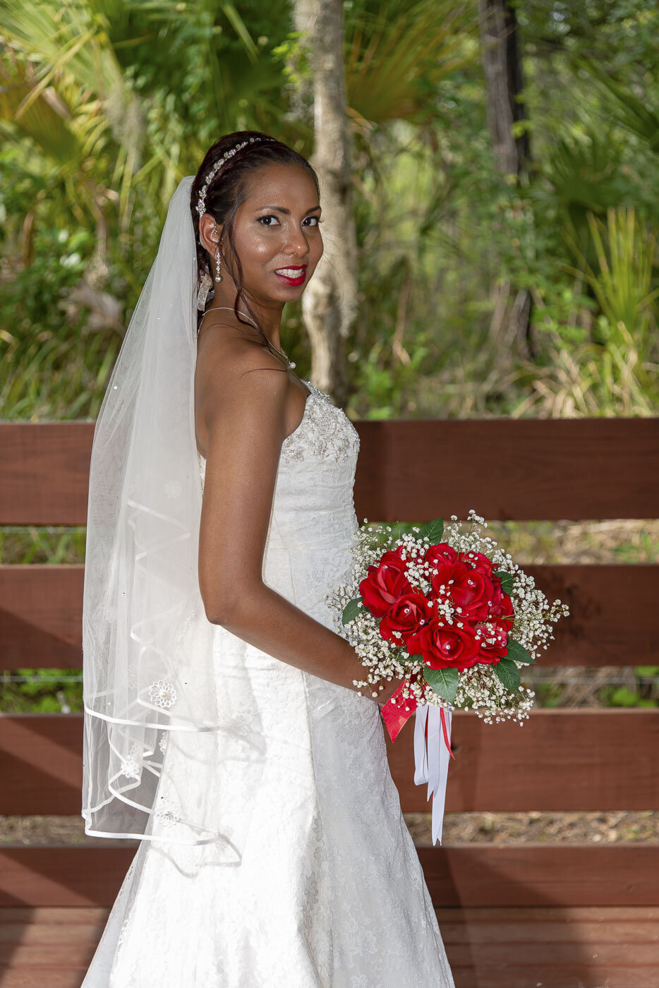 The bride poses for a bridal portrait