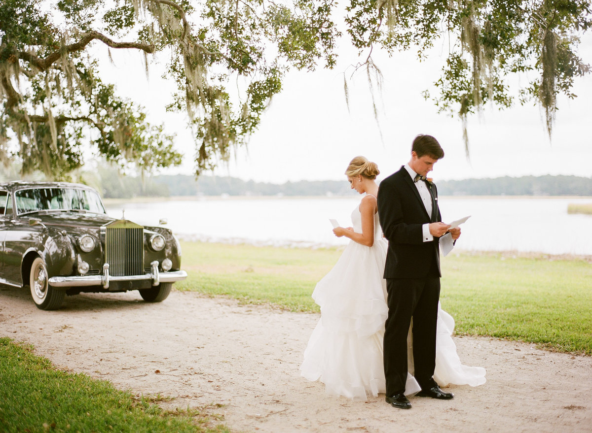 Bride and Groom Share Love Notes before Charleston Wedding Ceremony 1961 Grey Rolls Royce Lowcountry Valet