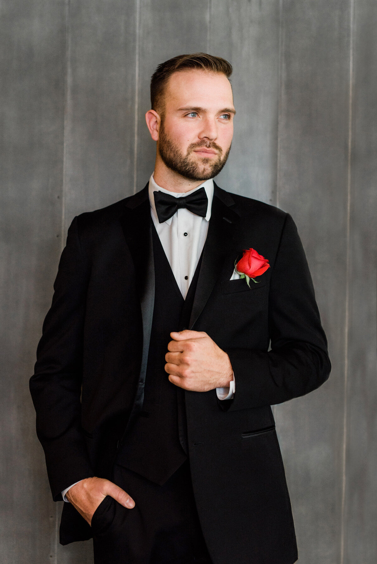 handsome groom poses in waterloo iowa