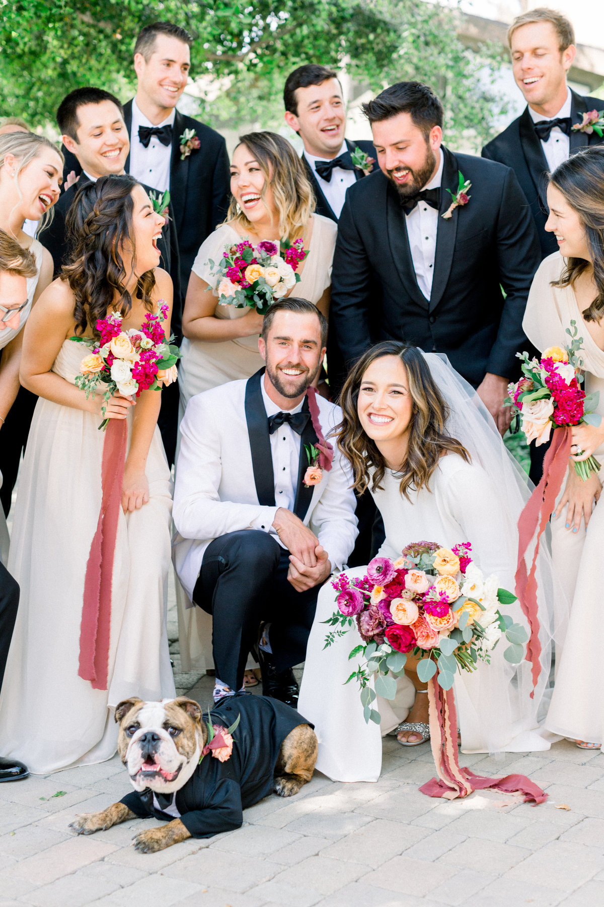Wedding party portrait shot with ring dog in tuxedo at Maravilla Gardens
