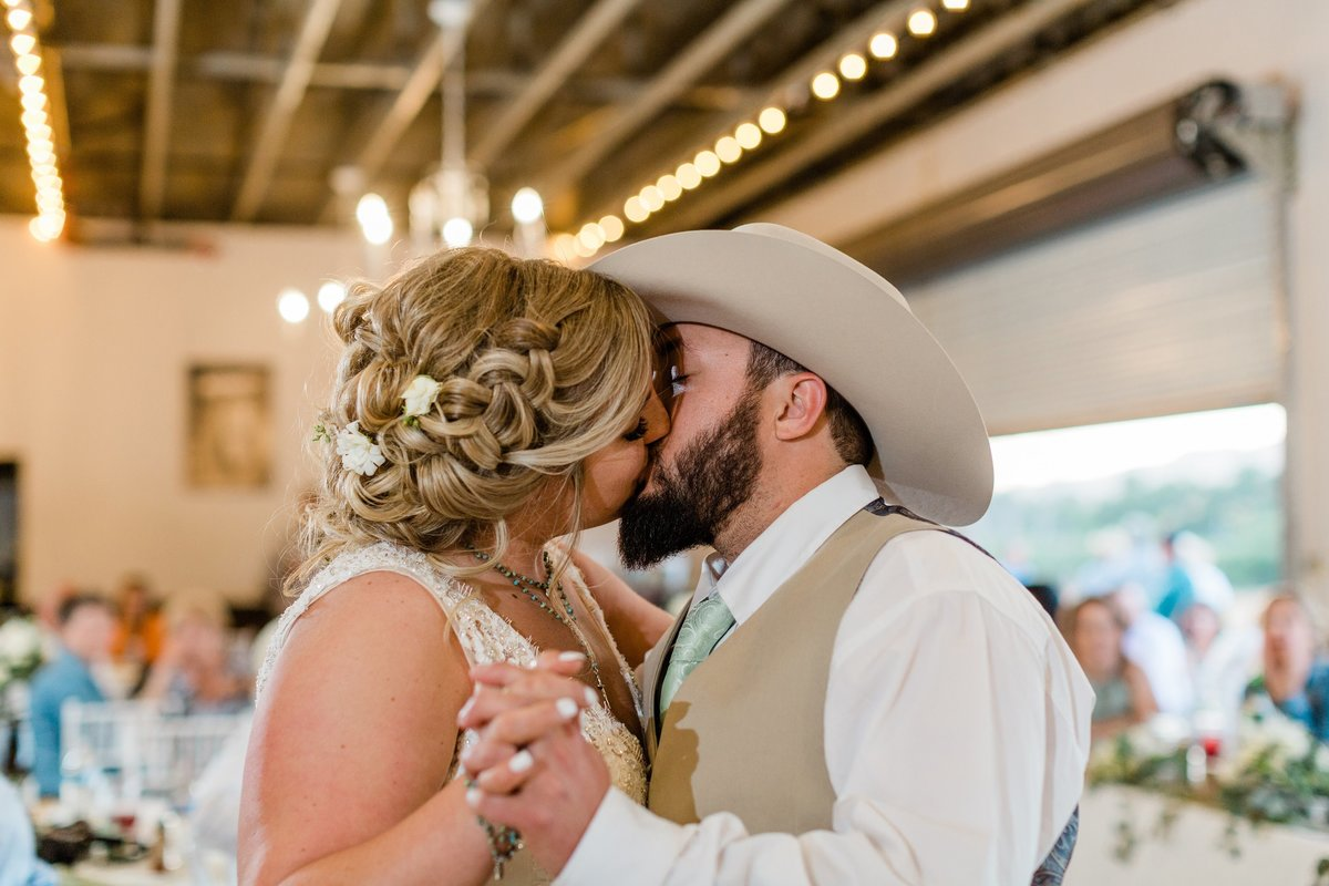 western style bride and groom kissing during their first dance