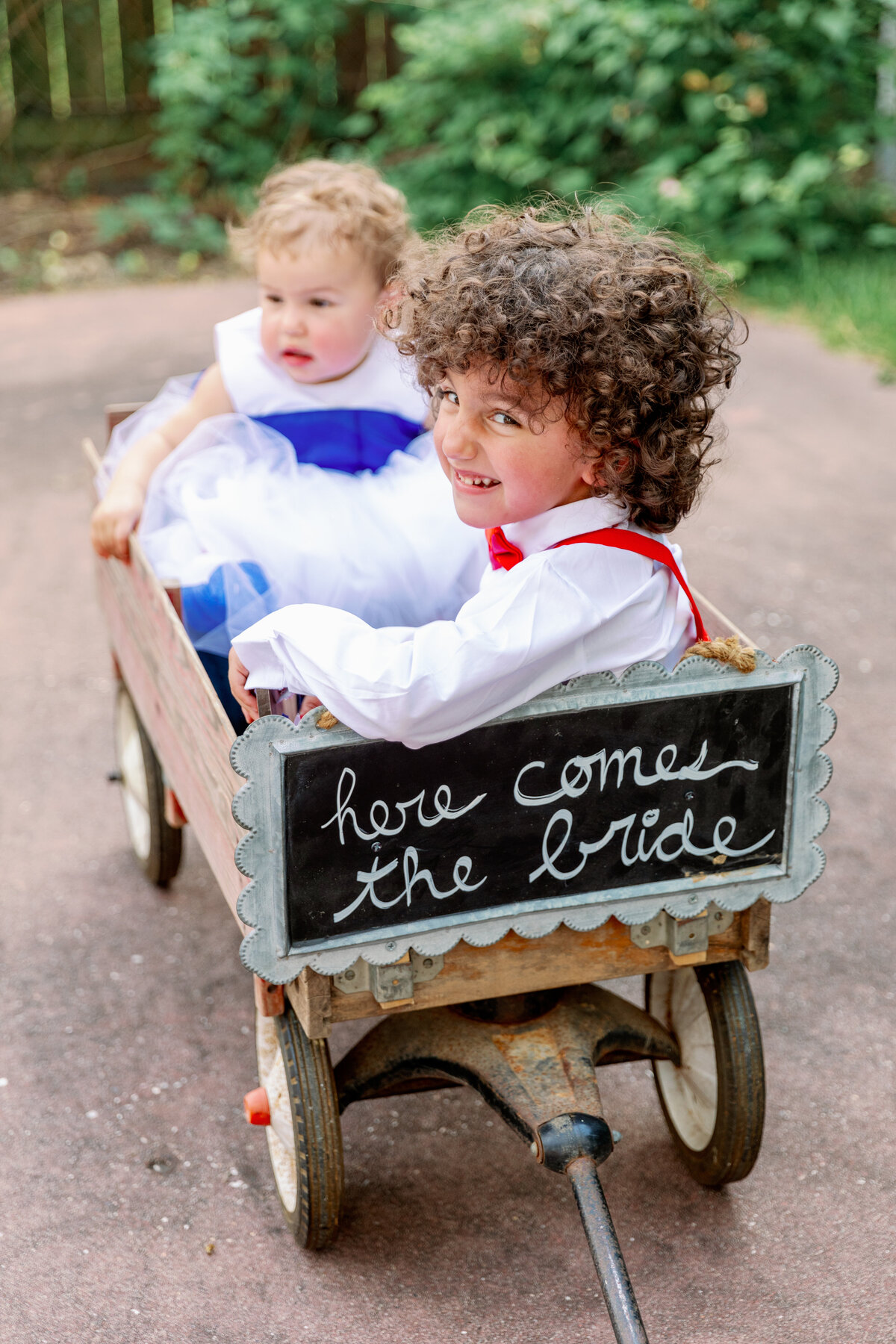 Flower Girl and Ring Bearer in a Wagon