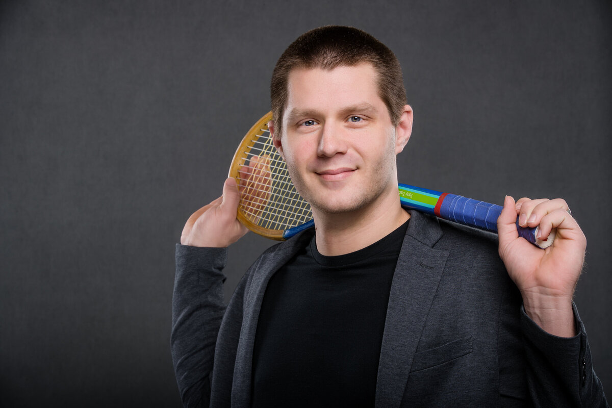 Tennis Pro holding tennis racket for headshot