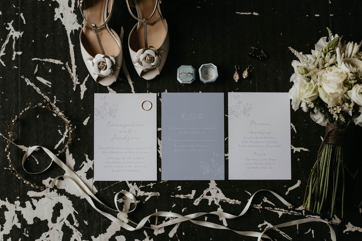 castlefield wedding stationary designs, bouquet, engagement ring, earrings,  and bridal shoes