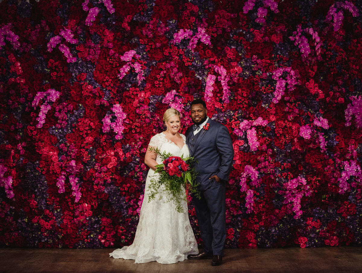 floral wall, jewel tones, ceremony backdrop