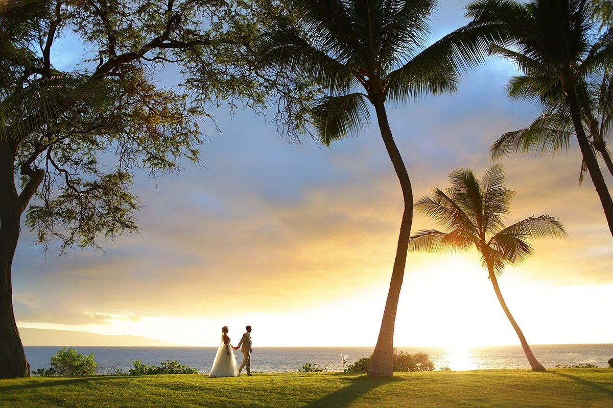 Andaz Maui wedding photographer couple holding hands and walking into sunset