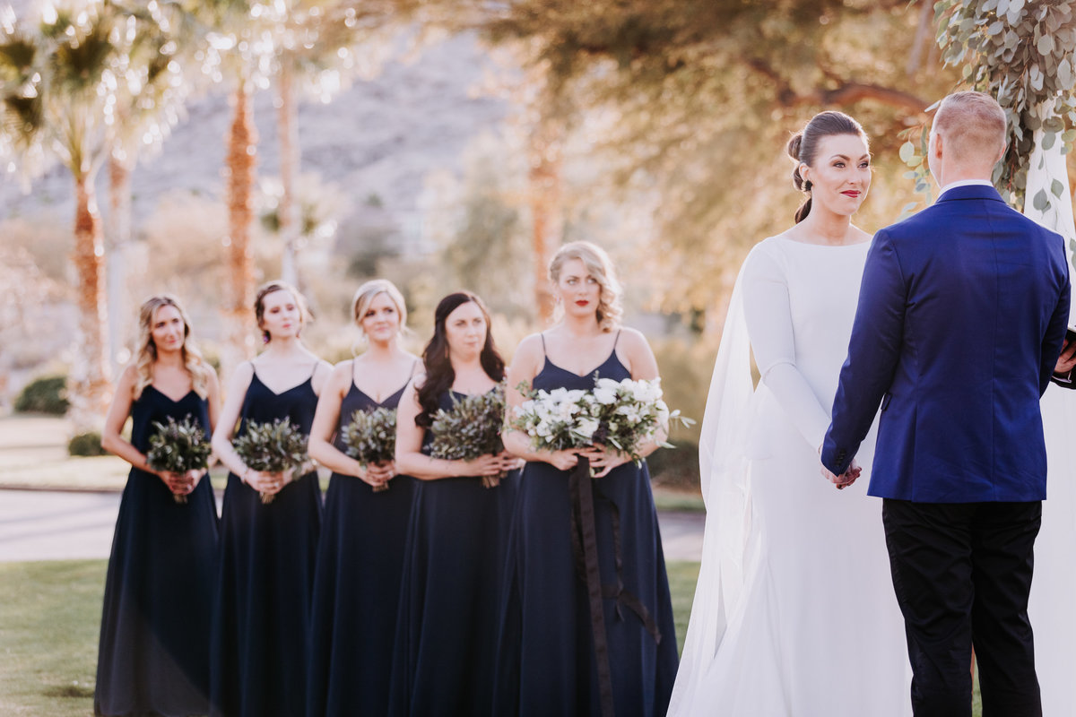 Lake Tahoe wedding pictures bride listens as groom says vows