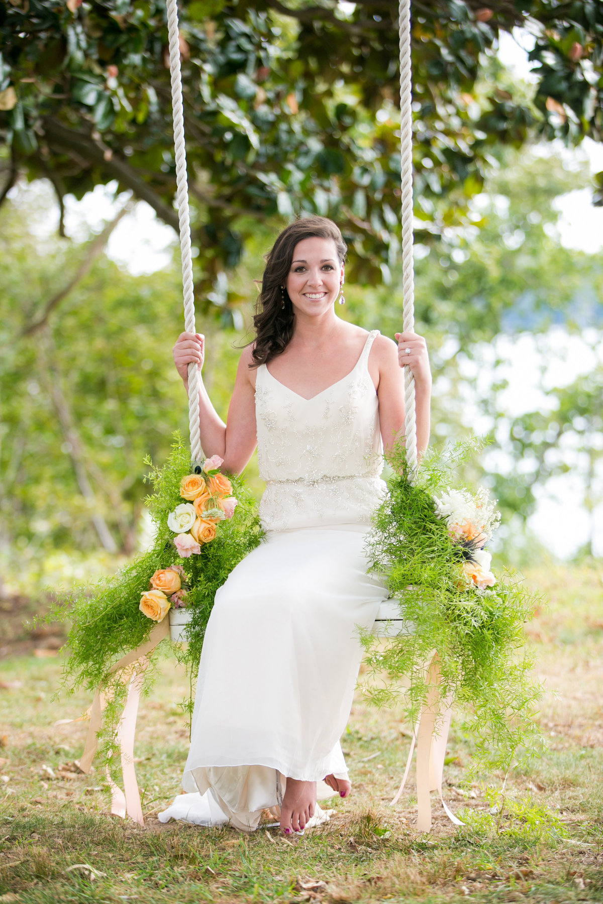 Bohemia Overlook wedding bride on a swing