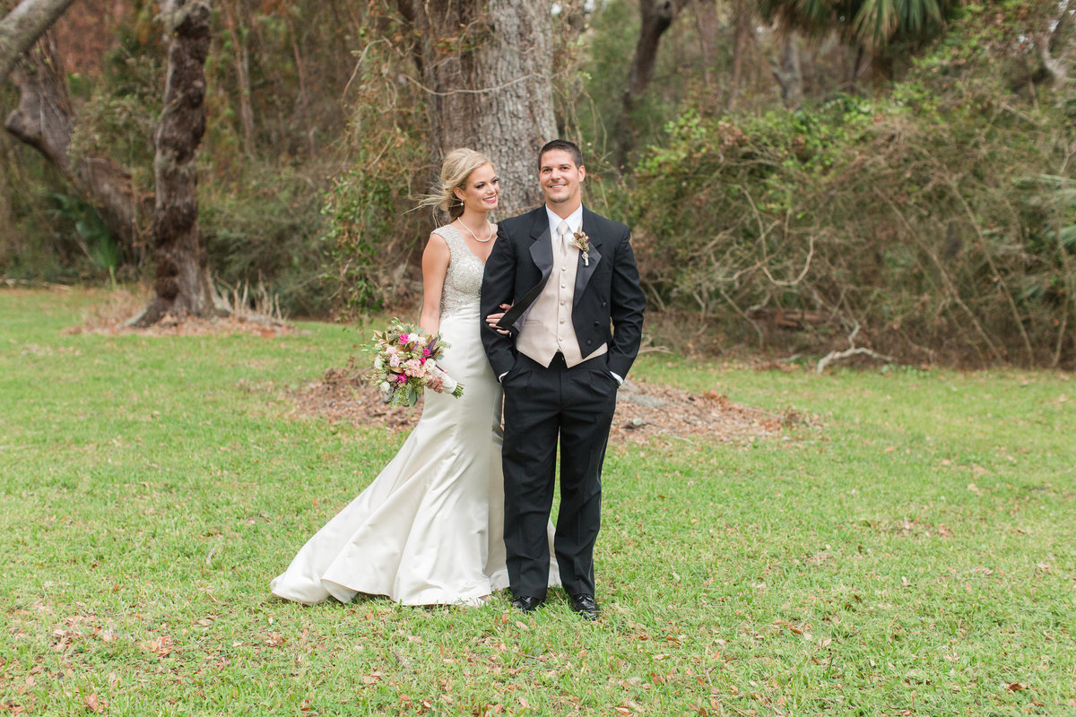 Bride smiling at her husband at Jekyll Island, Georgia wedding