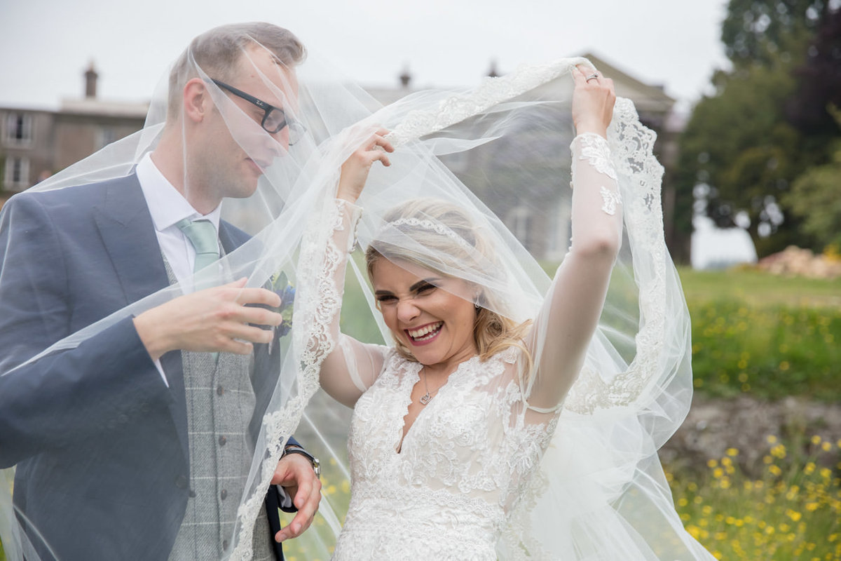 Bride and Groom under Brides Veil at Buckland House Wedding