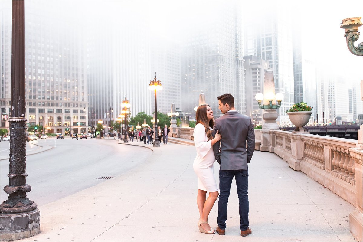 Engagement session in downtown Chicago on the riverwalk with fog