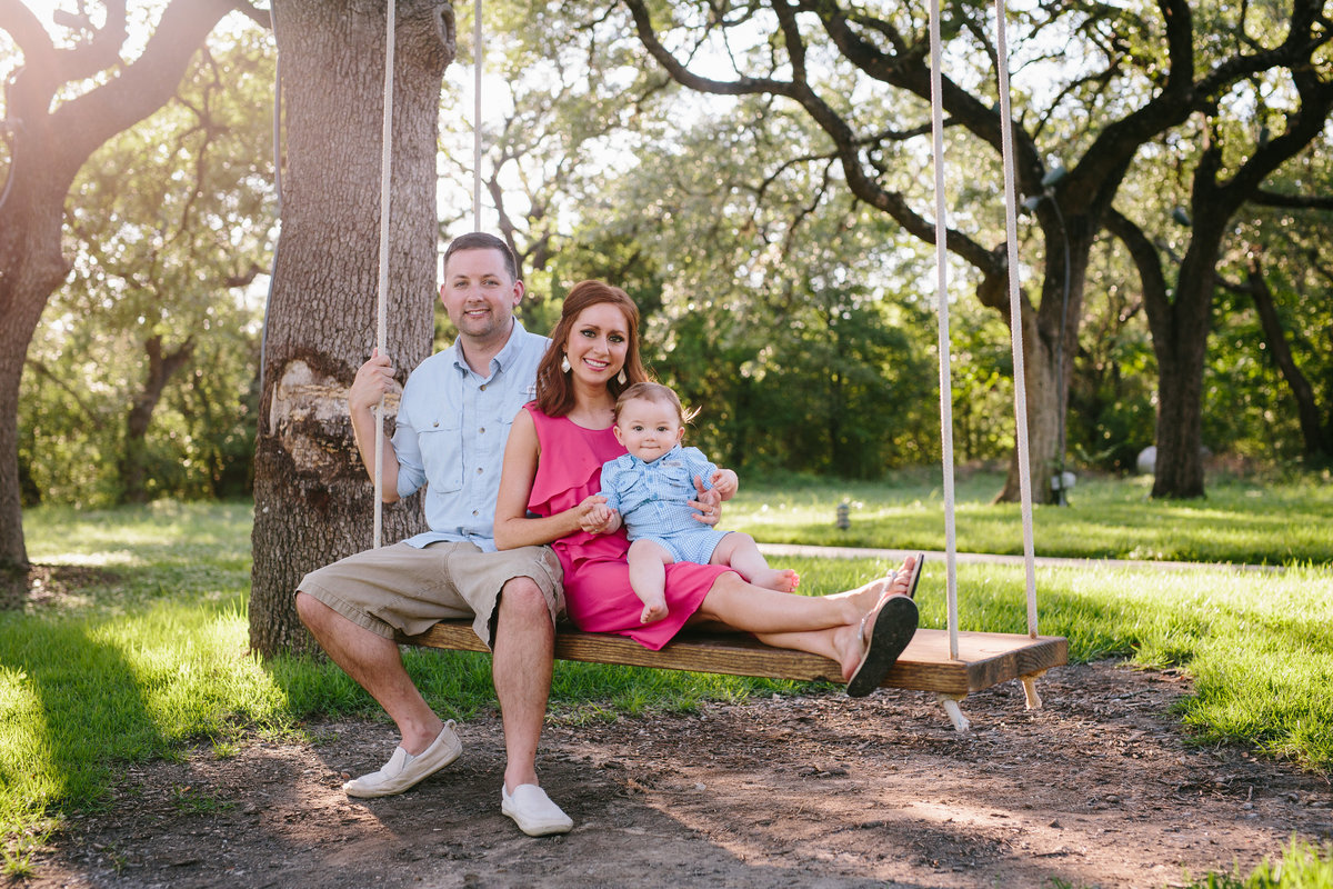 family photography sitting under a big tree on a swing by San Antonio Photographer Expose The Heart