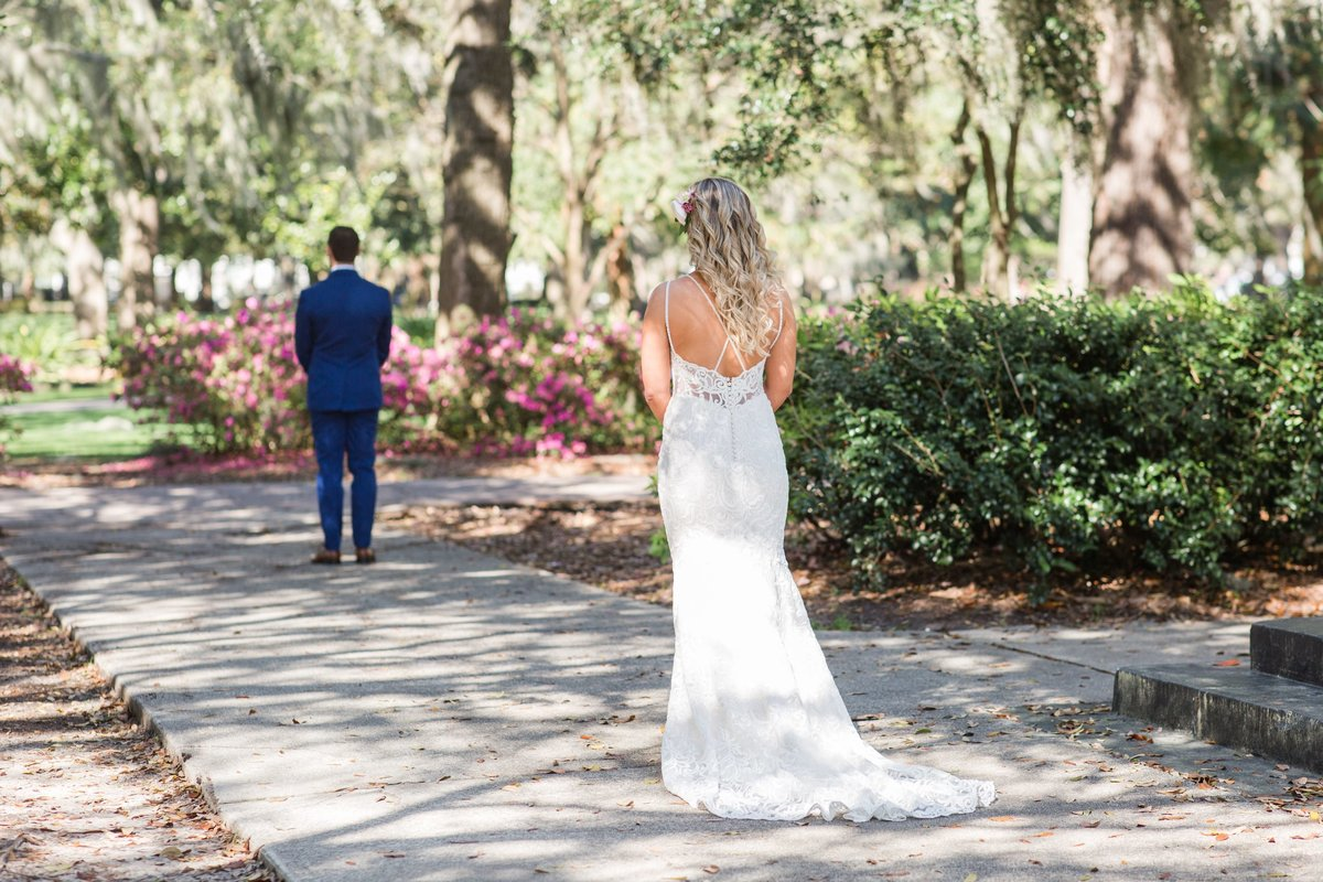 first look between bride and groom in forsyth park