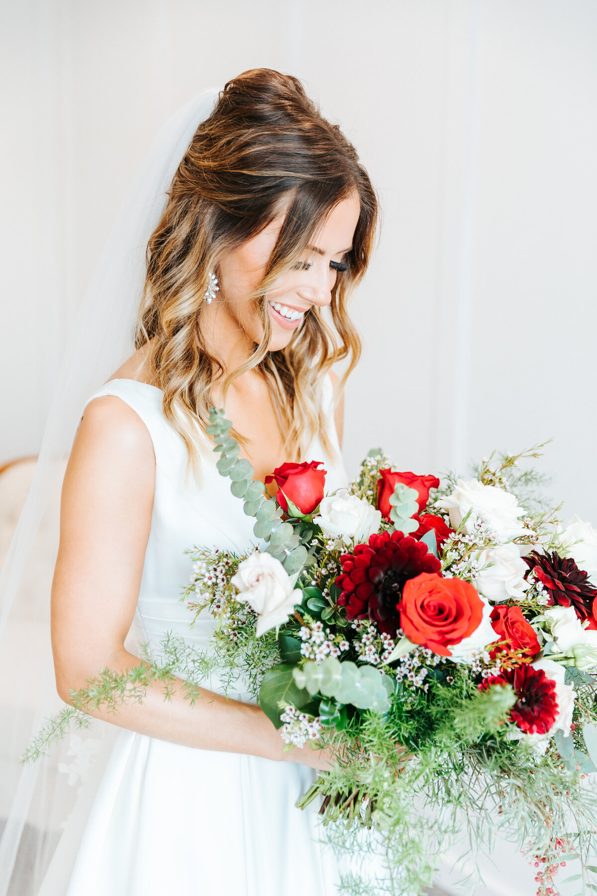Bride with Red Bouquet on her Wedding Day