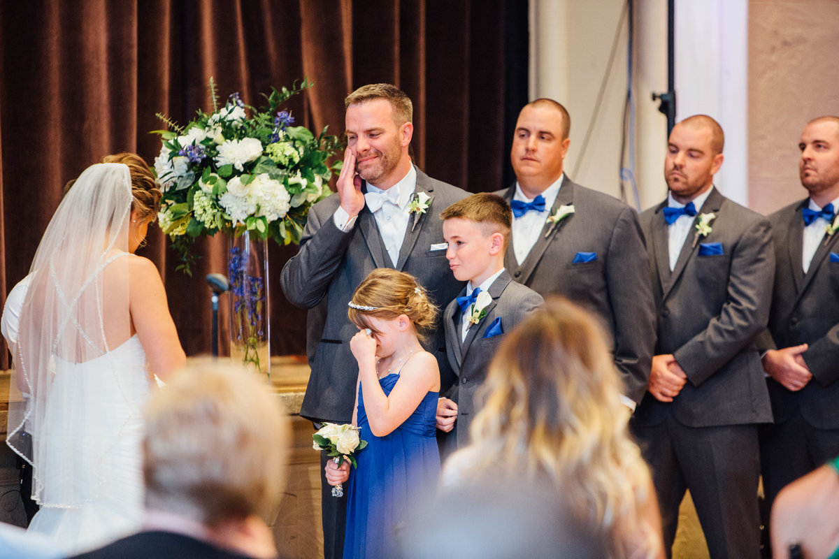 Groom and daughter crying