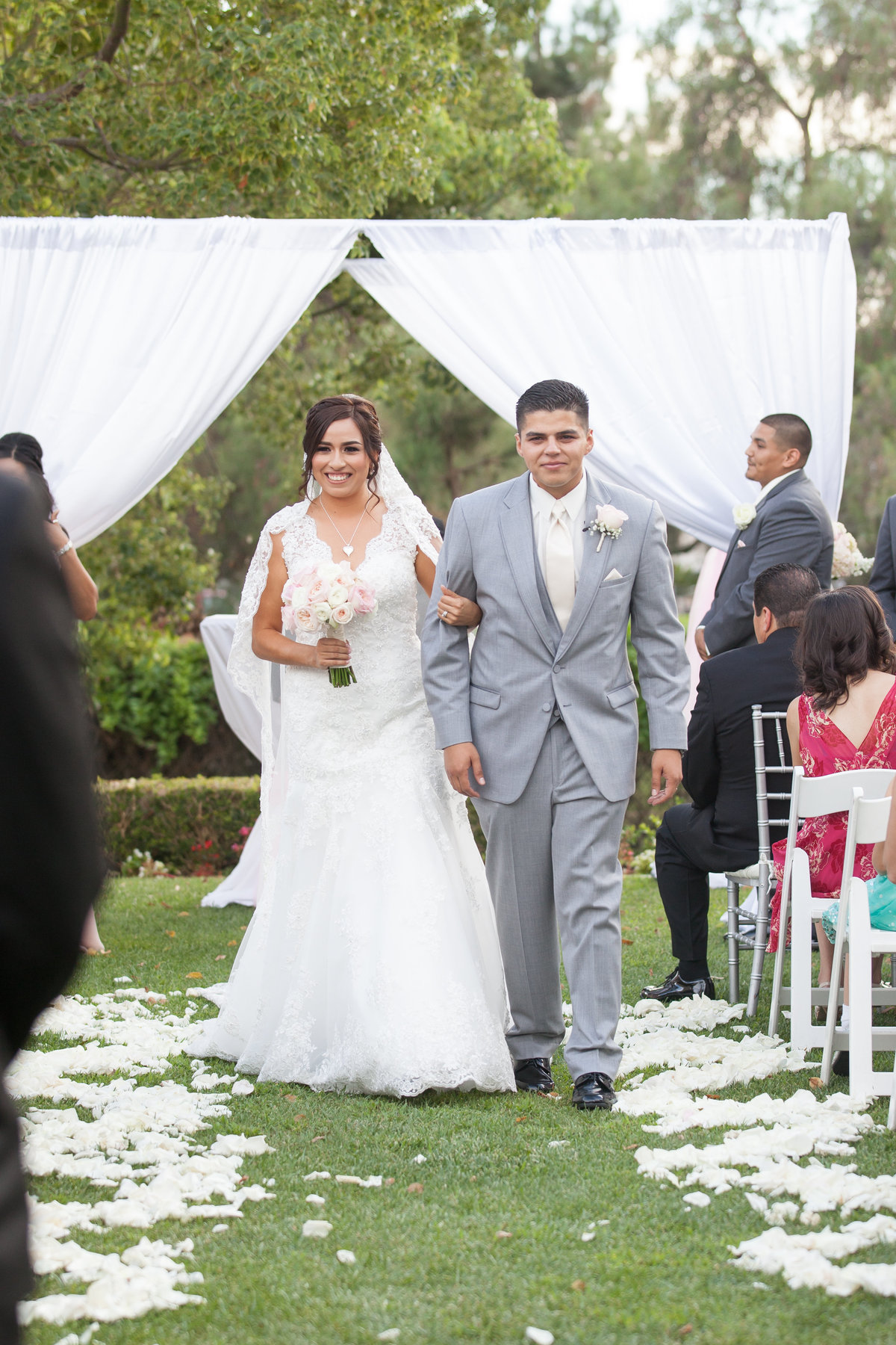 bride and groom walk during processional at pinterest wedding in los angeles california