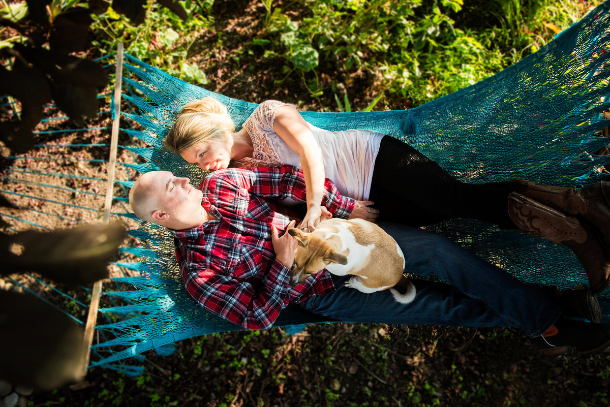 Family laying in a hammock with their pet in Ellensburg Washington