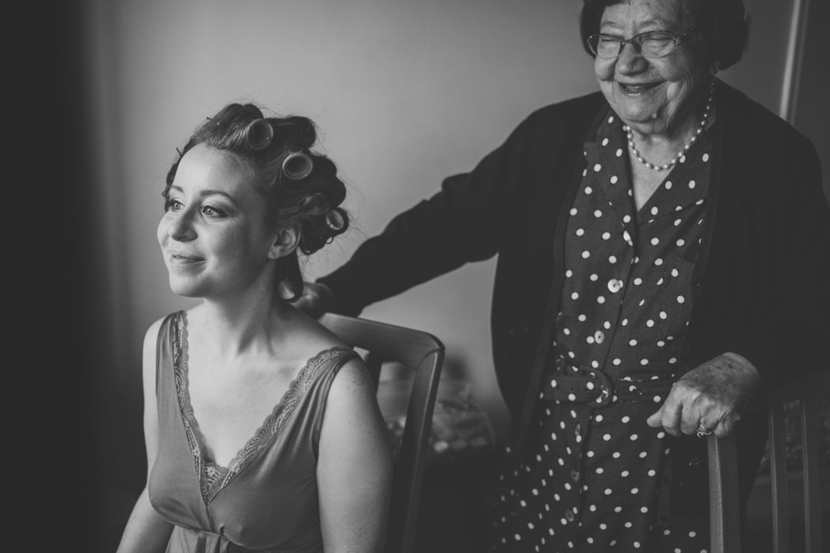 bride with grandma on the morning of her wedding in b&w