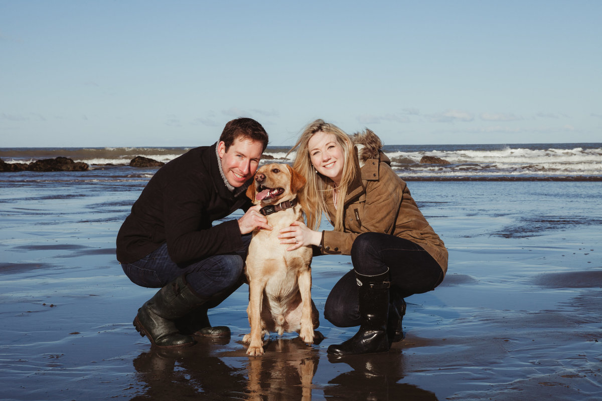 pre wedding dog engagement shoot at beach in water