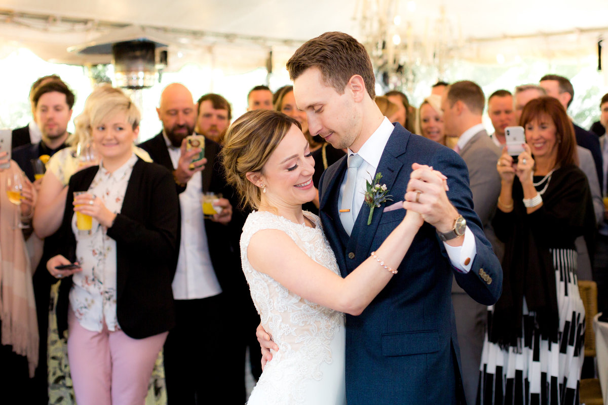 photographer captures bride and grooms first dance after becoming husband and wife