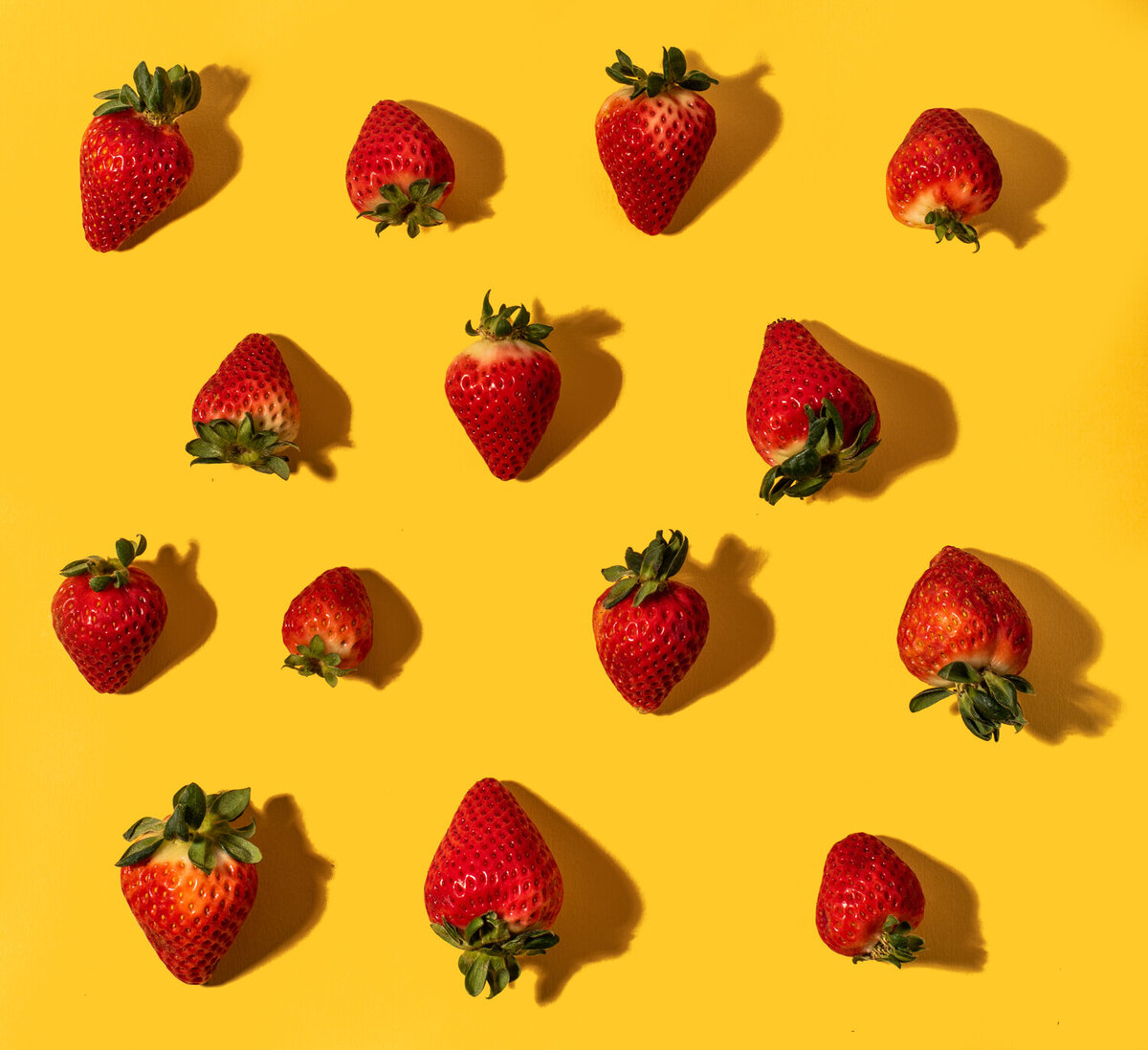 tiled strawberries on yellow