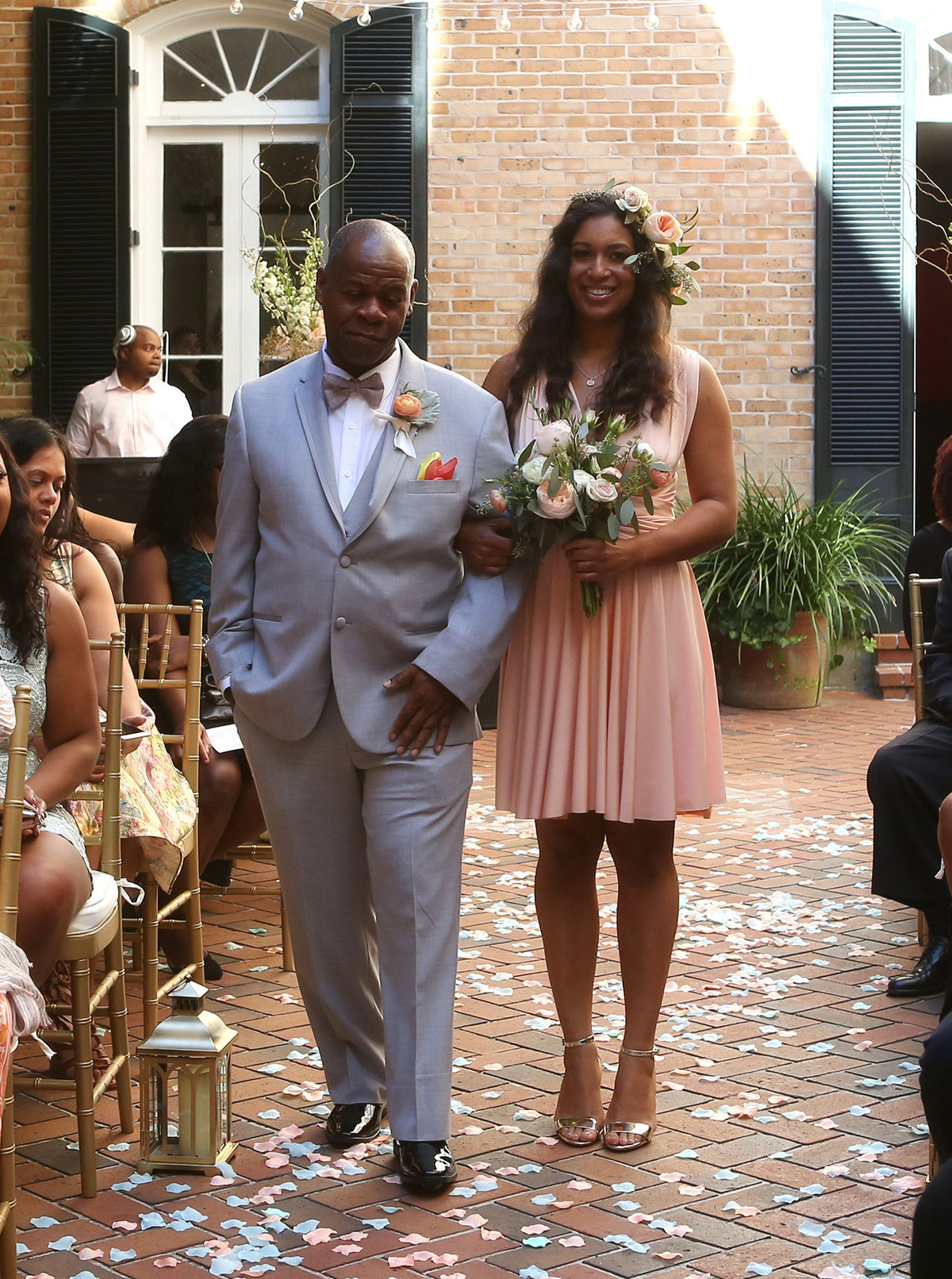 father of the groom walking bridesmaid down the aisle