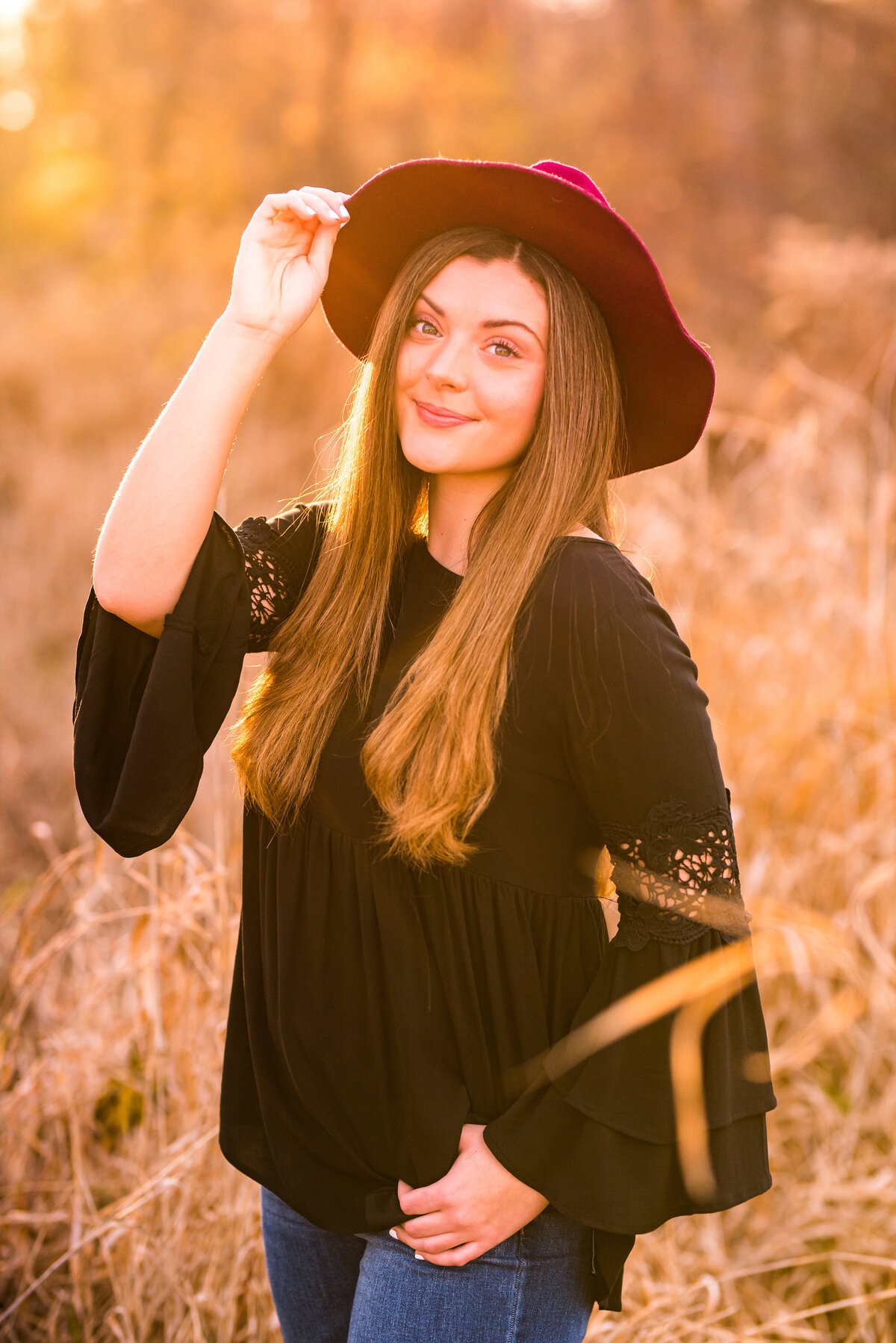Black Flowy Top with Bell Sleeves and Maroon Hat