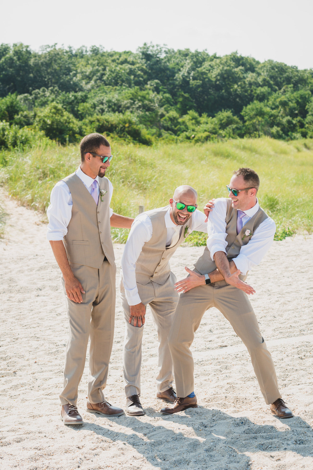 photo of groom with groomsmen on the beach from wedding at Pavilion at Sunken Meadow