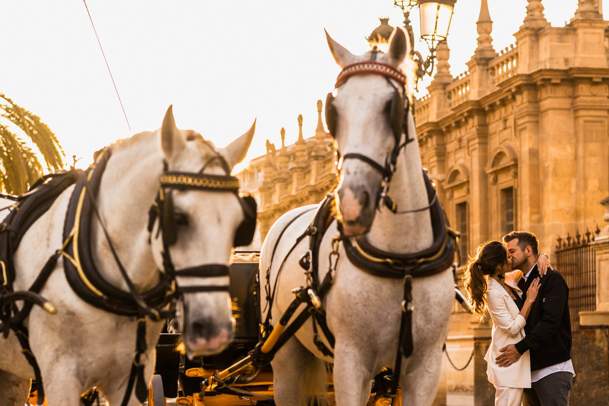 Bride & groom kiss in front of the  Catedral De Sevilla during their Sevilla wedding.