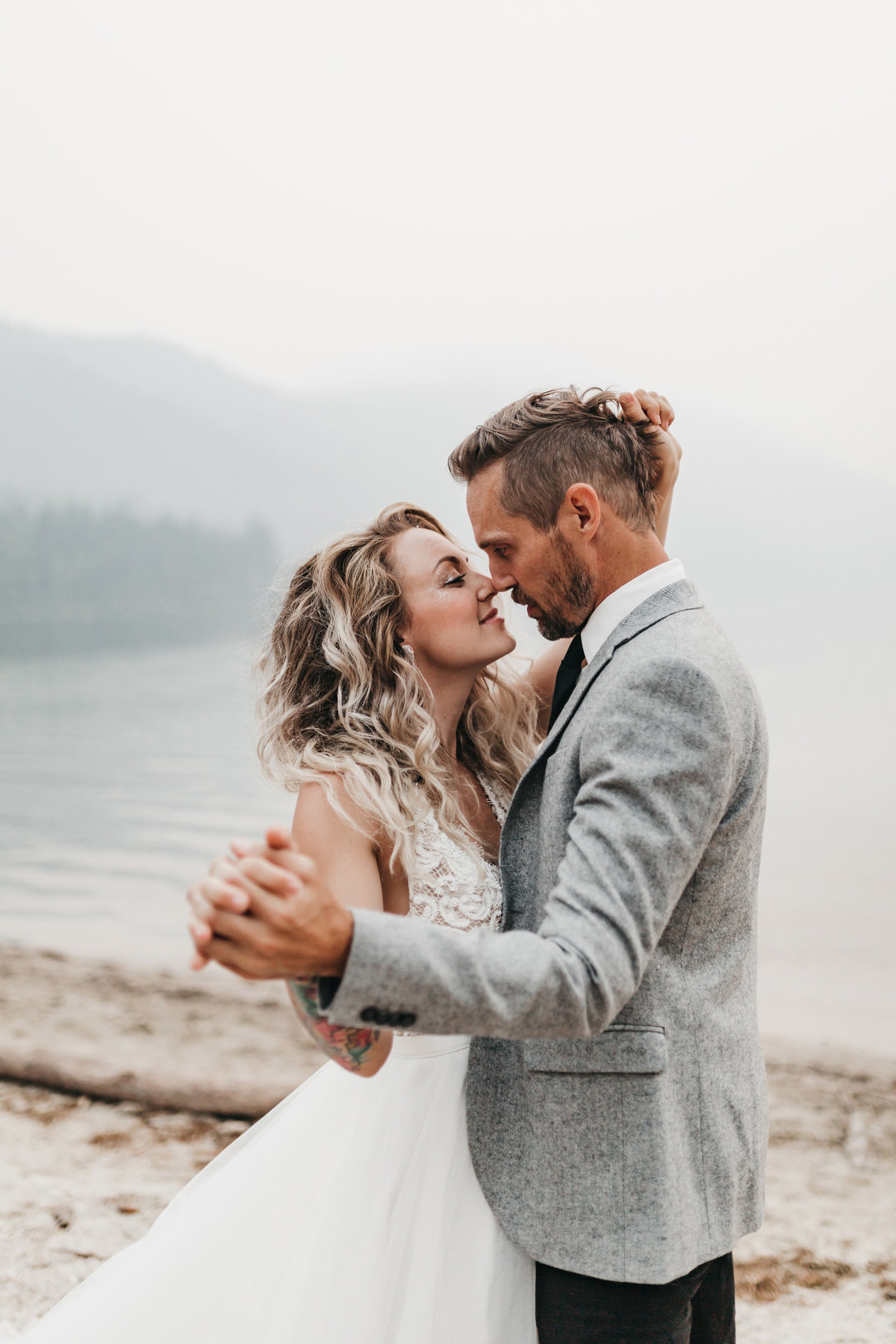 athena-and-camron-sara-truvelle-bridal-wenatchee-elopement-intimate-8-first-dance-nose-kiss