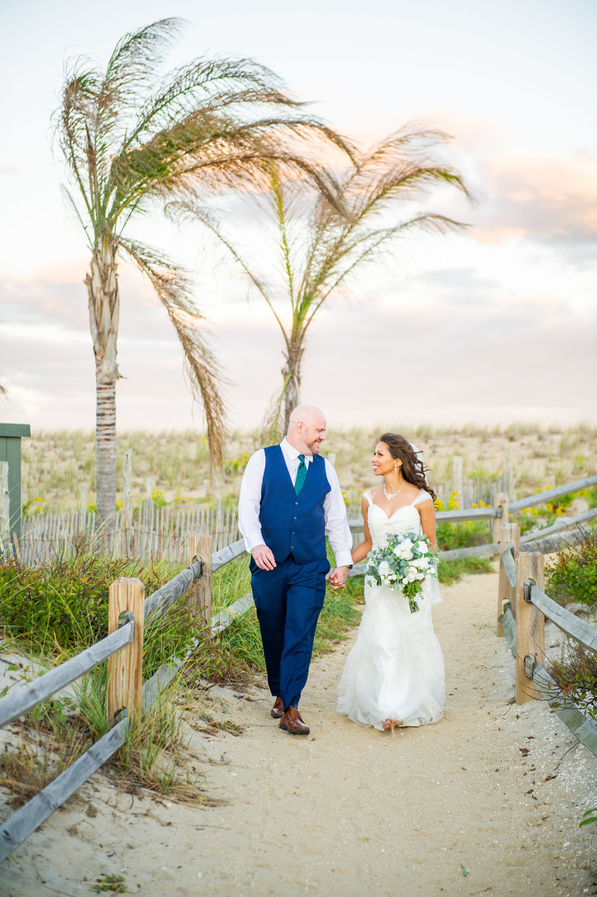 couple under palm trees at sea shell in beach haven