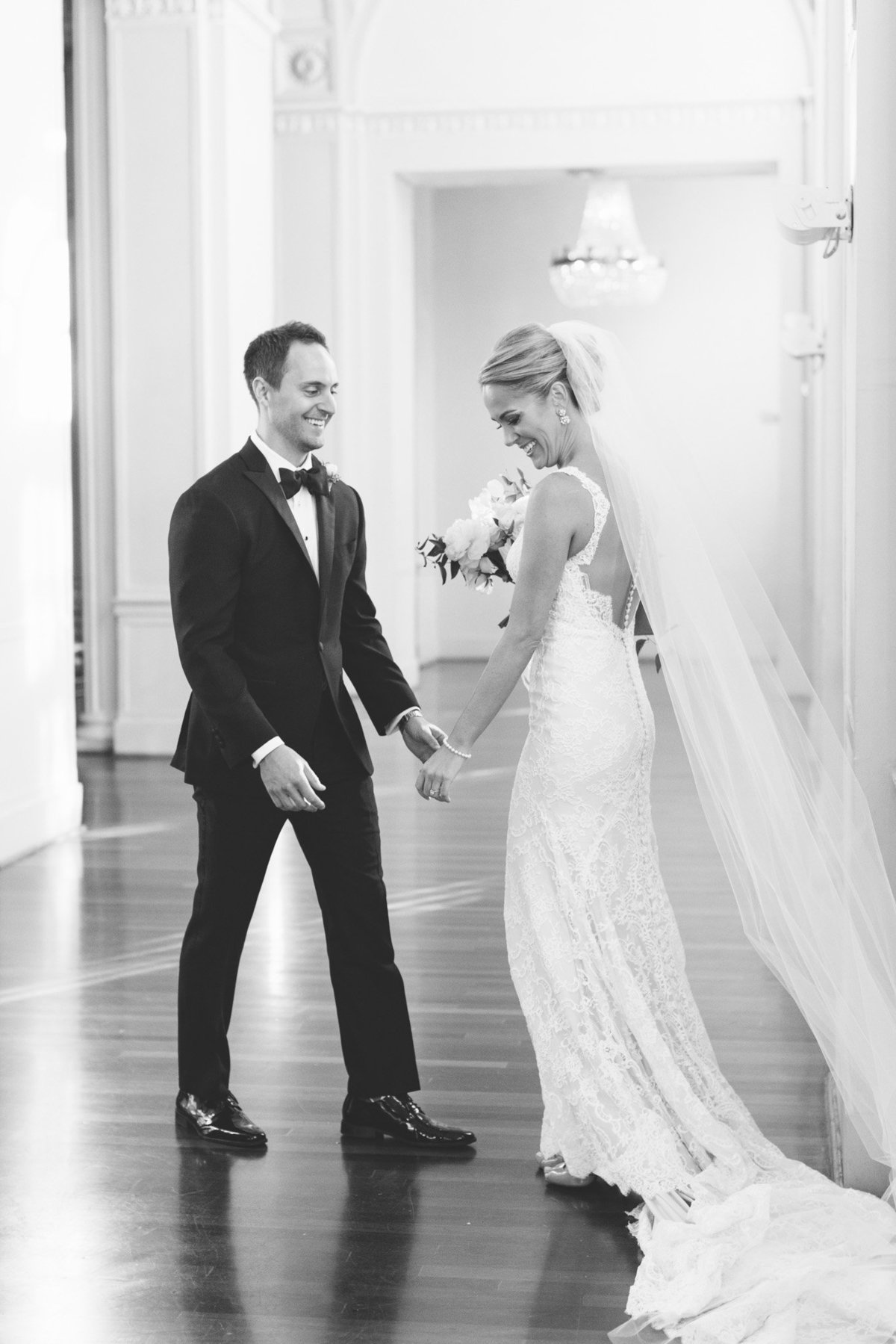 All the joy as this groom sees his bride at their first look in the Georgian ballroom at the Biltmore Atlanta.  Photo by Rebecca Cerasani.