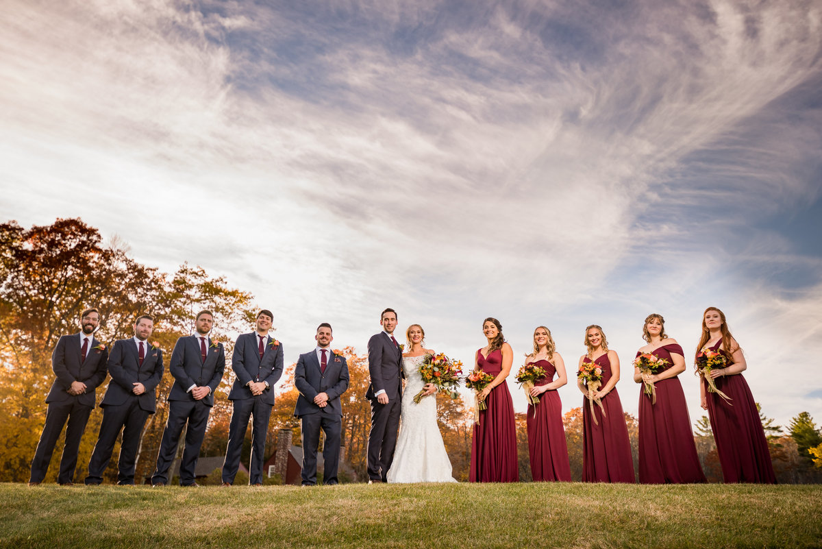 wedding party photo with golden leaves during the fall season NH outdoor wedding