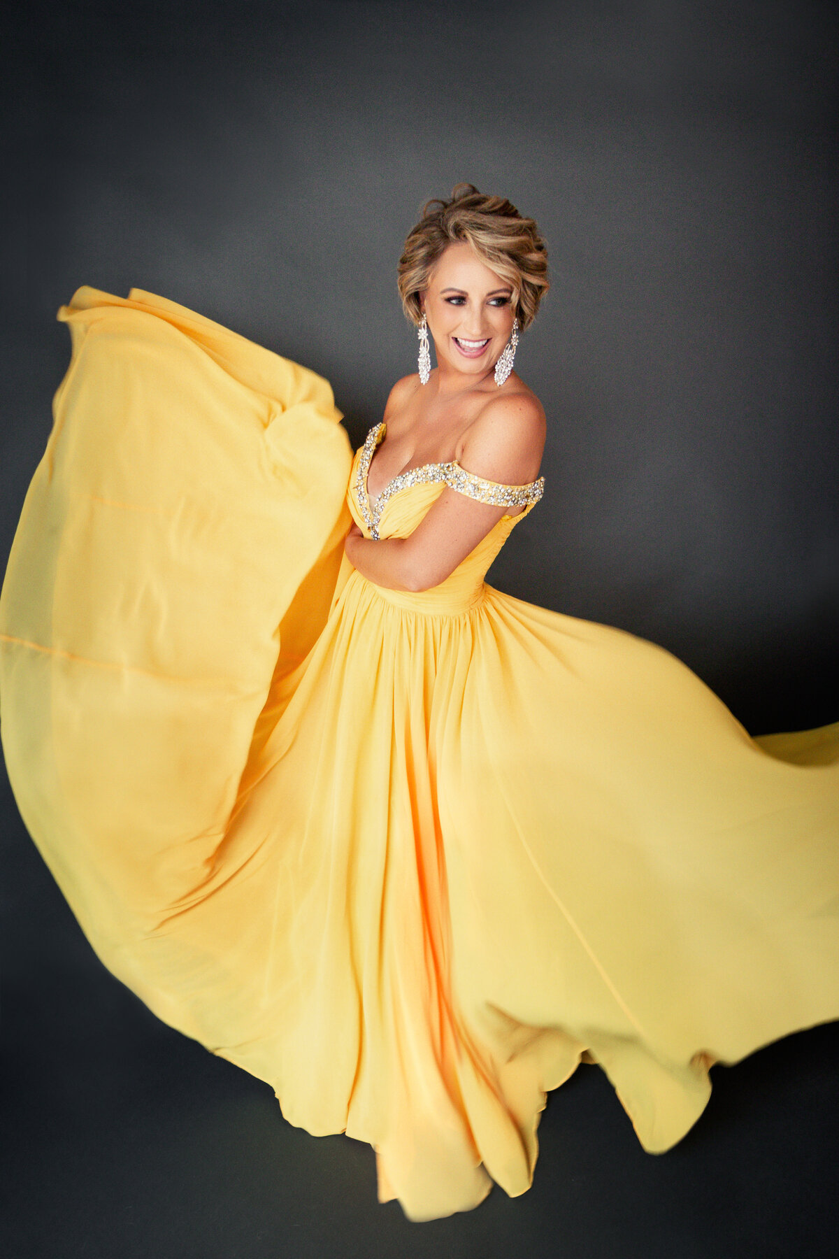 garland texas glamorous beauty portrait photography for woman laughing in yellow dress