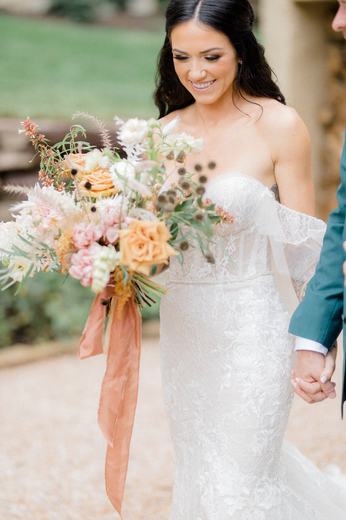 bride holding grooms hand and bouquet at private estate wedding in charlottesville Virginia by costola photography