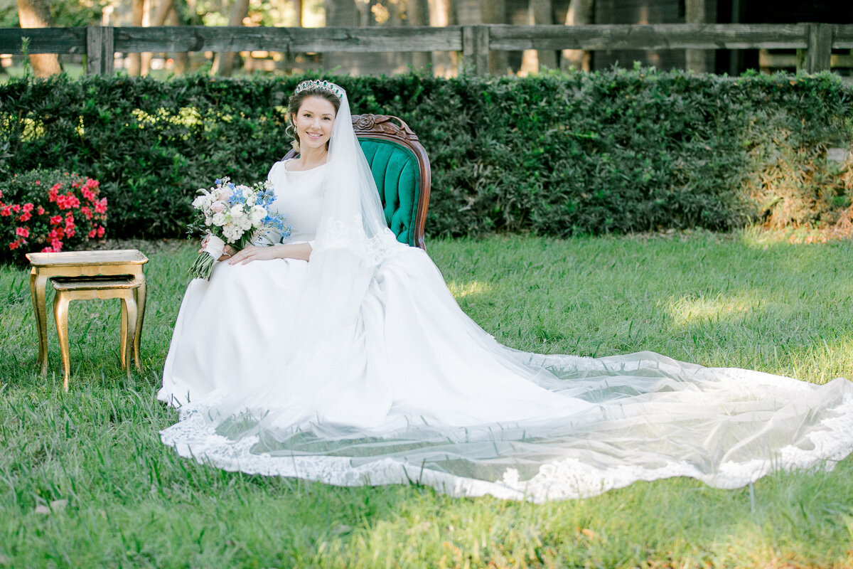 bride sitting on emerald chair