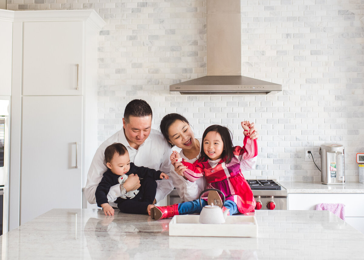 Des-Moines-Iowa-Family-Photographer-Theresa-Schumacher-Photography-Asian-Family-Kitchen-playing-laughing