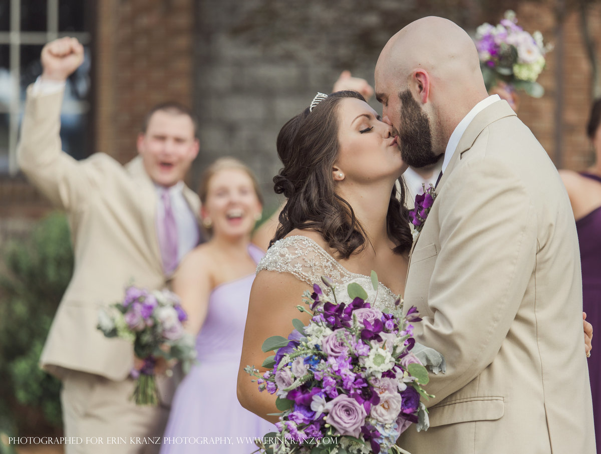 charlotte wedding photographer jamie lucido captures the bride and groom kissing in front of the castle at Barclay Villa in Raleigh North Carolina